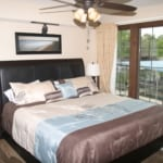 Condo_1122_Lakefront_bedroom_with_private_deck_access_Lake_of_the_Ozarks